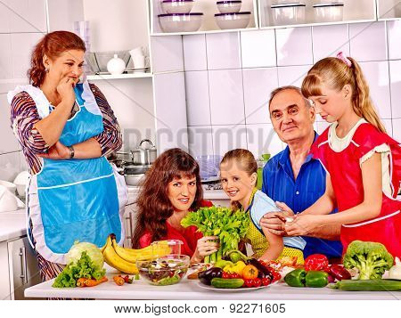 Happy very big family with kids cooking at kitchen. Grandfather and grandmother.