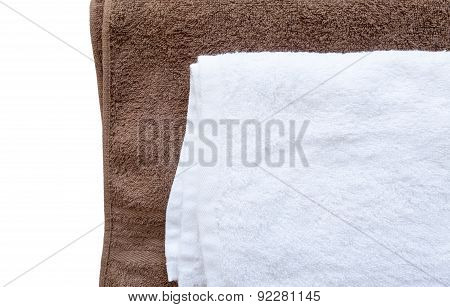 White clean towel on brown towel background