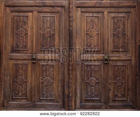 carved wooden double doors