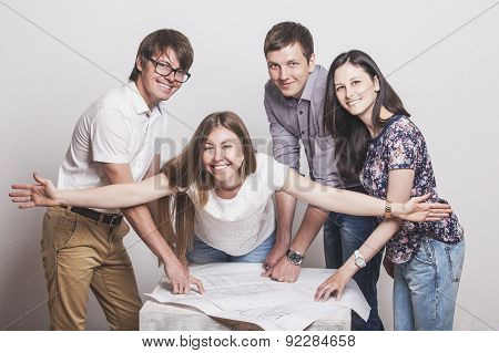 People Who Work With Drawings On The Table