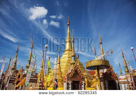 Golden pagoda and blue sky at Phra Borommathat temple Tak Province ,Thailand.