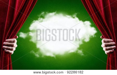 Close up of hand opening curtain. Place for text