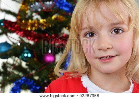 Girl Near Christmas Fir-tree
