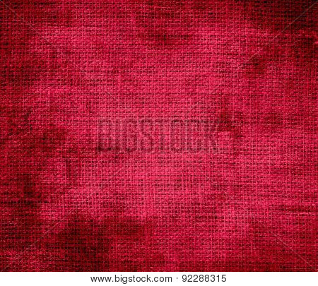 Grunge background of crimson glory burlap texture