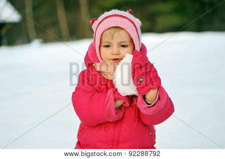 Girl In  Plays With Snow