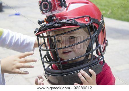Little Boy Wearing A Lacrosse Helmet