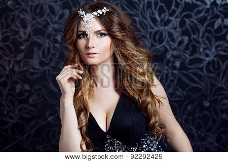 Beautiful Girl  With Long Brown Curled Hair,  Decoration On The Forehead