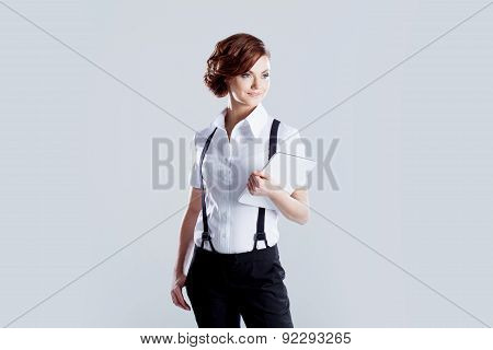 Successful Business Woman, On White Background, With Laptop In Hand