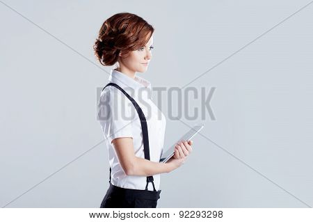 Successful Business Woman, On White Background, With Laptop In Hand, Profile