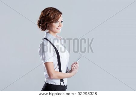 Successful Business Woman, With Laptop In Hand, Place For Text On The Right