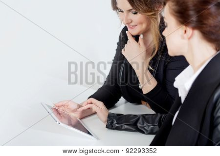 Cheerful Two Business Women, Girl Showing Something To Her Colleague