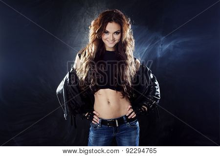 Portrait Of Young Cheerful Woman In The Leather Jacket, Rock Style