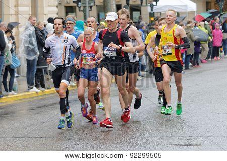 Group Of Runner On Wet Asphalt