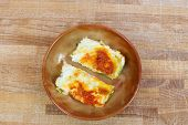 picture of lasagna  - tomato lasagna inside earthenware plate over wood - JPG