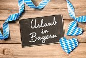foto of bavaria  - Board with German text Holidays in Bavaria - JPG