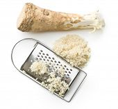 pic of grated radish  - grated horseradish root on white background - JPG