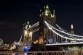 picture of london night  - The Tower bridge in London illuminated at night - JPG