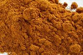picture of cayenne pepper  - top view of cayenne pepper heap and glass jar - JPG