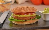 stock photo of burger  - Burger and guacamole sauce and ingredients - JPG