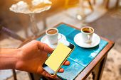 pic of hookah  - Using smartphone with empty screen in the turkish cafe with coffee and hookah on background - JPG