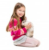 stock photo of rabbit year  - cute little girl in a crimson sweater  with baby rabbit over white - JPG