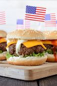 pic of beef-burger  - Close up to beef mini beef burger with American flag on topselective focus - JPG