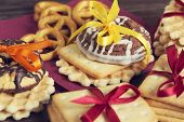 stock photo of biscuits  - Stack of delisious cookies and biscuits folded with ribbon - JPG
