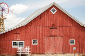 stock photo of red barn  - Red old barn on historical farm in Parker Colorado - JPG