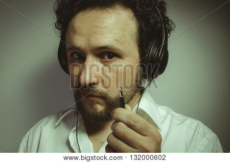 hate music, man with intense expression, white shirt