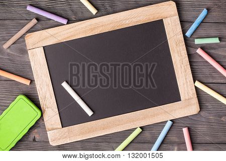 Blackboard sponge and chalks with copy space