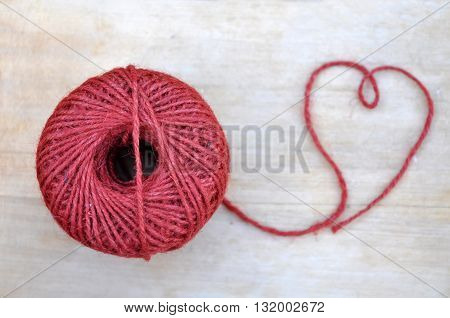 Red Rope Skein On The Wood Table