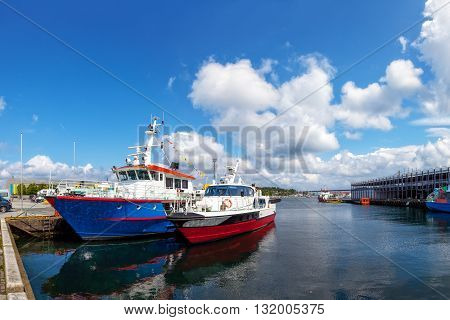 Two boats moored at the quay at the port of Stavanger Norway.