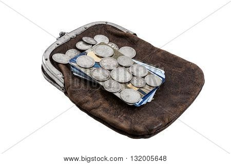 silver Russian coins of the 19th century against credit cards and an ancient purse