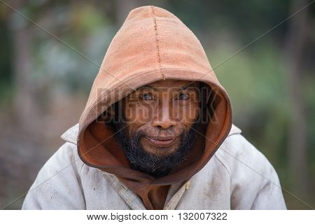 MRAUK-U MYANMAR - JANUARY 27 2016: Unknown portrait beggar man Burma