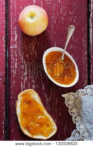 Useful toast with apple jam on a wooden background. Homemade jam. Top view .Organic and healthy food