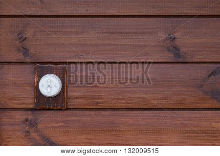 one retro light switch on wooden background