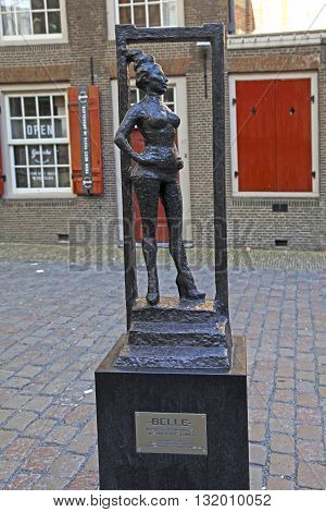 AMSTERDAM, NETHERLANDS - MAY 5, 2016: Monument of prostitute «Belle» near Old Church in Red lights district Amsterdam Netherlands. Selective focus