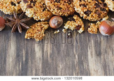 Homemade cookies from sesame seeds raisins and caramel on the old wooden background. Top view . Copy space for you text