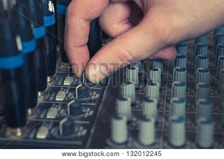 hand on music mixer - studio equipment macro