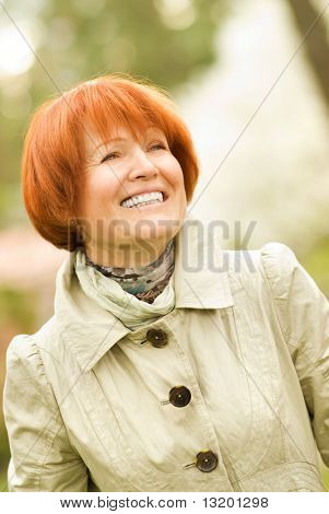 Beautiful smiling middle-aged woman outdoors