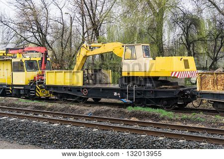 special yellow railway wagon on a track - excavator.