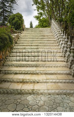 Beautiful old decorated stair in a garden.