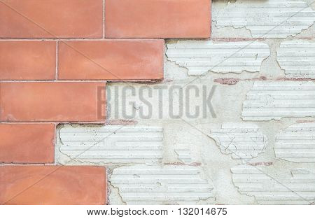 Closeup old and damaged red stone brick wall texture background