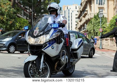 Monte-Carlo Monaco - May 28 2016: Police Motorcyclist Escort of the Prince of Monaco during the Monaco Formula 1 Grand Prix 2016