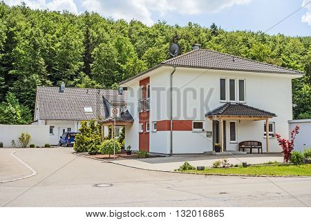 Custom built house view from the street residential neighborhood Germany