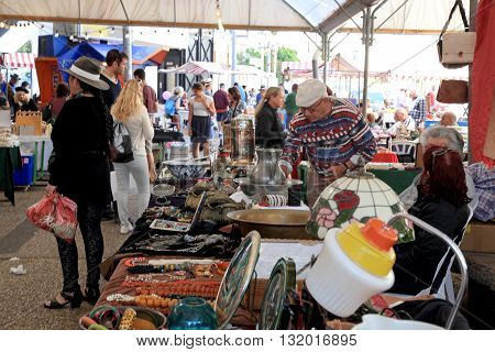 TEL AVIV, ISRAEL - APRIL 1, 2016 : Visitors and sellers on The Flea Market Shuk Hapishpeshim in Jaffa, Tel Aviv, Israel. It's an open air market - magnet for visitors tourists and lovers of bargains and second hand items. Selective focus