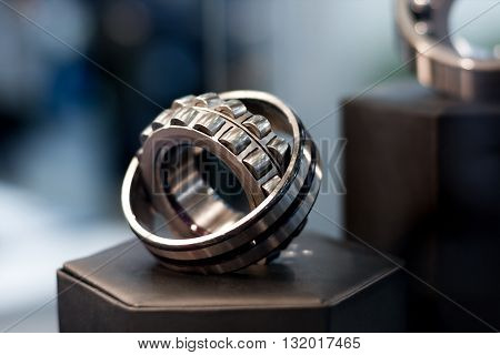 Metal cylindrical bearing for heavy industry with bokeh background
