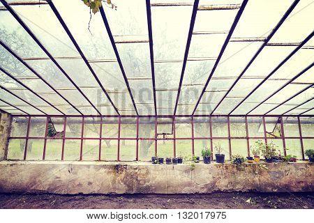 Vintage Toned Old Empty Glasshouse.