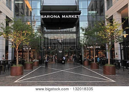 TEL AVIV, ISRAEL - APRIL 7, 2016 : People in Sarona Food Market in Tel Aviv, Israel. Recently open Sarona Market became the most popular place in Tel Aviv.