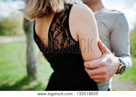 Close Up Of Hand Of Boy Who Hug His Girlfriend. Couple In Love